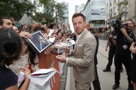 """Director Ewan McGregor signs autographs at Lionsgate's """"American Pastoral"""" Premiere at the 2016 International Film Festival on Friday, Sept. 9, 2016, in Toronto. (Photo by Eric Charbonneau/Invision for Lionsgate/AP Images)"""