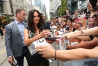 """Jennifer Connelly signs autographs at Lionsgate's """"American Pastoral"""" Premiere at the 2016 International Film Festival on Friday, Sept. 9, 2016, in Toronto. (Photo by Eric Charbonneau/Invision for Lionsgate/AP Images)"""